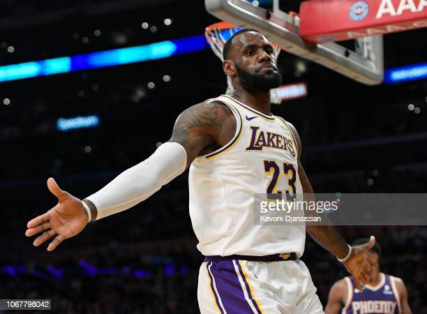 LeBron James of the Los Angeles Lakers celebrates after a slam dunk against the Phoenix Suns during the second half at Staples Center on December 2...