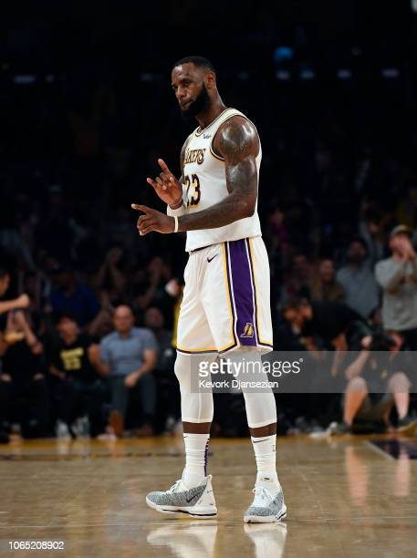 LeBron James of the Los Angeles Lakers celebrates after making a 26 foot three point shot at the halftime buzzer against Orlando Magic at Staples...