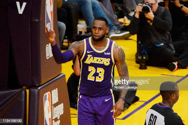 LeBron James of the Los Angeles Lakers celebrates after passing Michael Jordan and moving to on the NBA's all-time scoring list during the second...