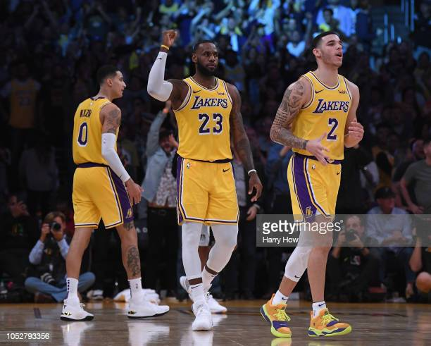 LeBron James of the Los Angeles Lakers celebrates his basket in overtime between Lonzo Ball and Kyle Kuzma during a 143142 loss to the San Antonio...
