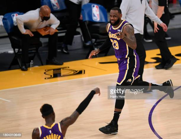 LeBron James of the Los Angeles Lakers celebrates his dunk with Dennis Schroder during a 102-93 Lakers win at Staples Center on February 26, 2021 in...