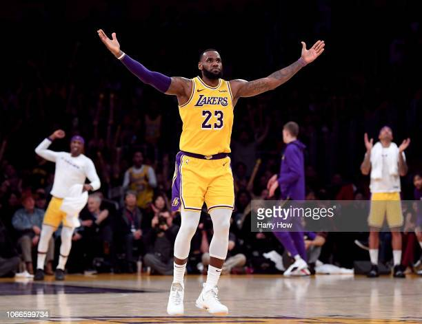 LeBron James of the Los Angeles Lakers celebrates his three pointer during a 104-96 win over the Indiana Pacers at Staples Center on November 29,...