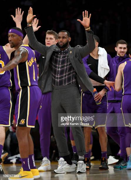 LeBron James of the Los Angeles Lakers celebrates on the bench after a three point basket by Lonzo Ball of the Los Angeles Lakers in the first half...