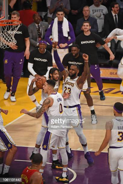 LeBron James of the Los Angeles Lakers celebrates the game winning block against the Atlanta Hawks on November 11 2018 at Staples Center in Los...
