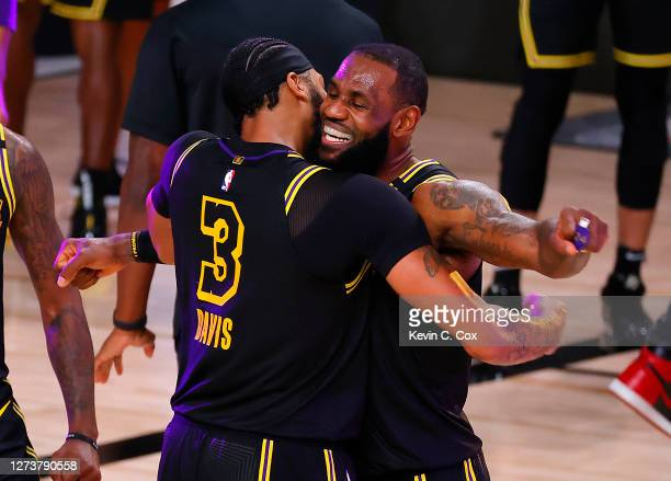 LeBron James of the Los Angeles Lakers celebrates with Anthony Davis of the Los Angeles Lakers after shooting a three point basket to win the game...