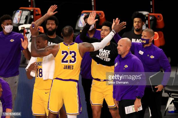 LeBron James of the Los Angeles Lakers celebrates with his teammates after defeating the LA Clippers after the game at The Arena at ESPN Wide World...