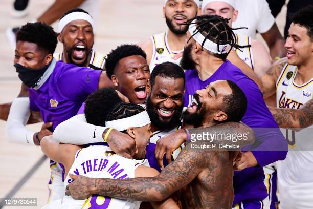 LeBron James of the Los Angeles Lakers celebrates with Quinn Cook of the Los Angeles Lakers and teammates after winning the 2020 NBA Championship in...
