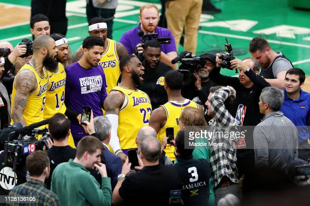 LeBron James of the Los Angeles Lakers celebrates with Rajon Rondo after Rondo scored the game winning basket against the Boston Celtics during the...