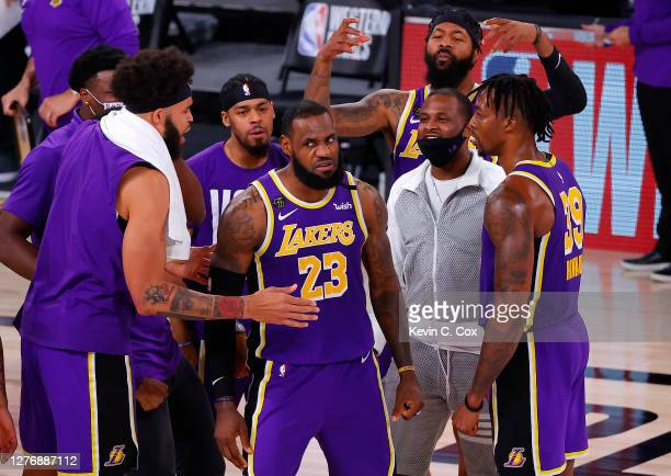 LeBron James of the Los Angeles Lakers celebrates with teammates after their win against the Denver Nuggets in Game Five of the Western Conference...