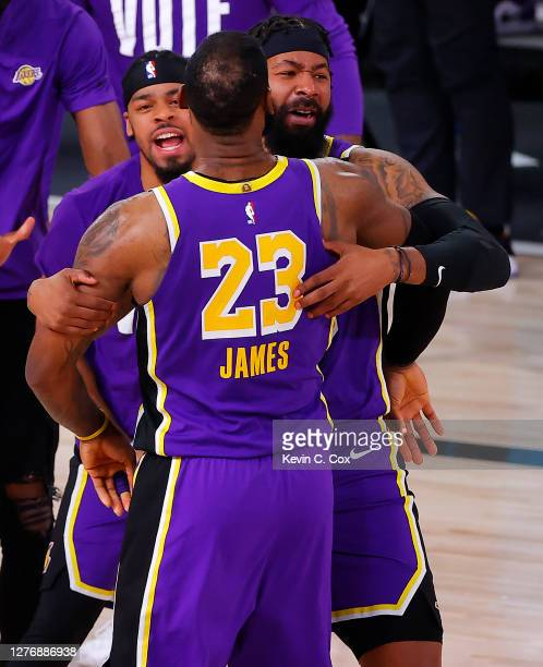LeBron James of the Los Angeles Lakers celebrates with teammates during the fourth quarter against the Denver Nuggets in Game Five of the Western...