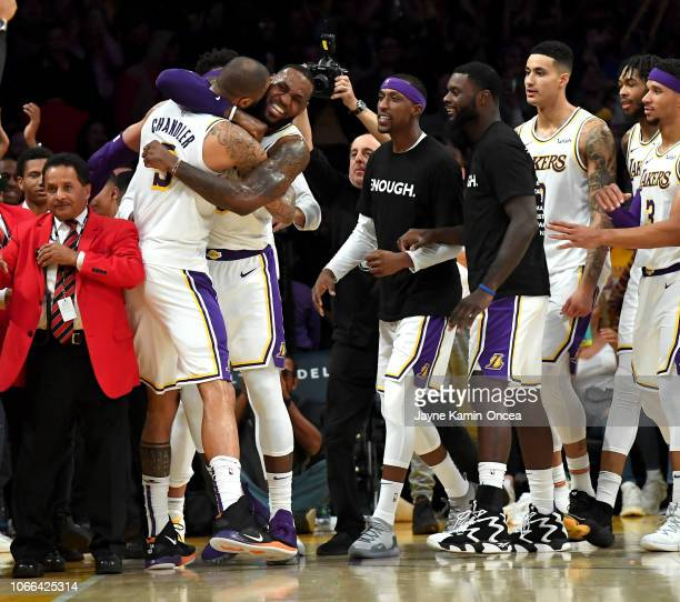 LeBron James of the Los Angeles Lakers celebrates with Tyson Chandler of the Los Angeles Lakers after he blocked the final shot of the game by Trae...