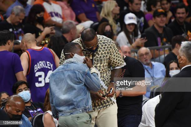 LeBron James of the Los Angeles Lakers chats with Rich Paul in the game of the Milwaukee Bucks against the Phoenix Suns during Game Five of the 2021...