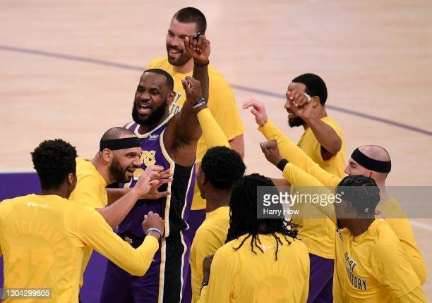 LeBron James of the Los Angeles Lakers cheers on his teammates before the game against the Portland Trail Blazers at Staples Center on February 26,...