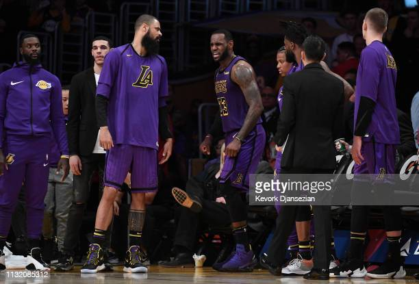 LeBron James of the Los Angeles Lakers comes out of the game after falling during the second half against Brooklyn Nets during the basketball game at...