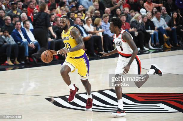 LeBron James of the Los Angeles Lakers controls the ball against AlFarouq Aminu of the Portland Trail Blazers in the second quarter of their game at...