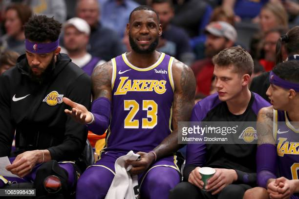 Lebron James of the Los Angeles Lakers cools down on the bench while playing the Denver Nuggets in the fourth quarter at the Pepsi Center on November...