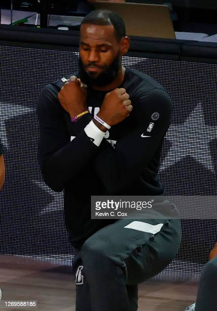 LeBron James of the Los Angeles Lakers crosses his arms for the Wakanda salute during a moment of silence to honor the death of actor Chadwick...