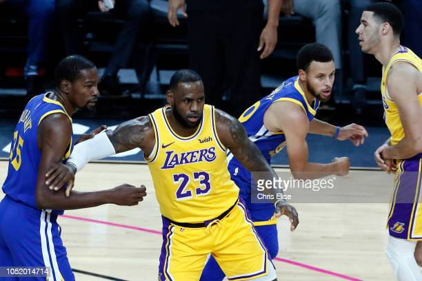 LeBron James of the Los Angeles Lakers defends against Golden State Warriors during the game on October 10 2018 at TMobile Arena in Las Vegas Nevada...