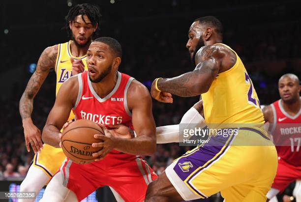 LeBron James of the Los Angeles Lakers defends Eric Gordon of the Houston Rockets during the first quarter at Staples Center on October 20 2018 in...