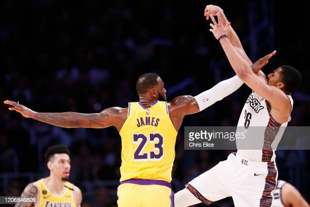 LeBron James of the Los Angeles Lakers defends on Spencer Dinwiddie of the Brooklyn Nets during a game at the Staples Center on March 10 2020 in Los...