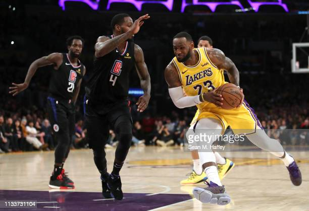 LeBron James of the Los Angeles Lakers dribbles past JaMychal Green of the Los Angeles Clippers during the second half of a game against the Los...