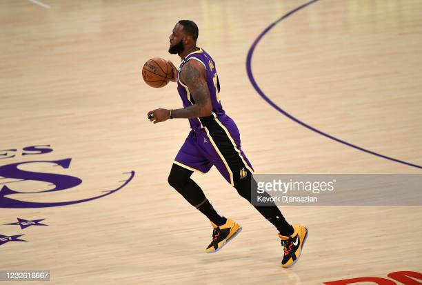 LeBron James of the Los Angeles Lakers dribbles the ball after returning to the starting lineup against the Sacramento Kings at Staples Center on...