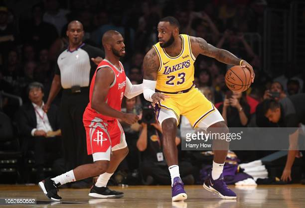 LeBron James of the Los Angeles Lakers dribbles the ball against Chris Paul of the Houston Rockets during the first quarter at Staples Center on...