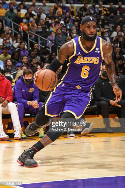LeBron James of the Los Angeles Lakers dribbles the ball against the Phoenix Suns on October 22, 2021 at STAPLES Center in Los Angeles, California....