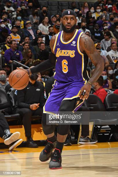 LeBron James of the Los Angeles Lakers dribbles the ball against the Phoenix Sunson October 22, 2021 at STAPLES Center in Los Angeles, California....