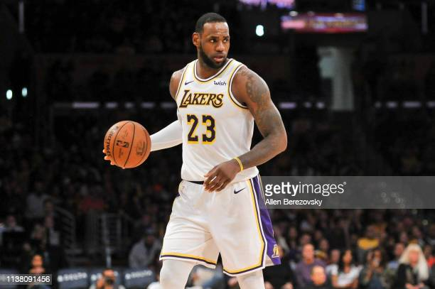 LeBron James of the Los Angeles Lakers dribbles the ball during a game against the Sacramento Kings at Staples Center on March 24 2019 in Los Angeles...