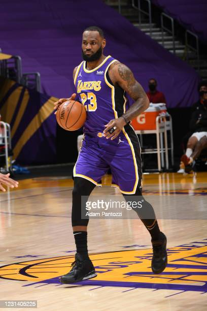 LeBron James of the Los Angeles Lakers dribbles the ball during the game against the Portland Trail Blazers on February 26, 2021 at STAPLES Center in...