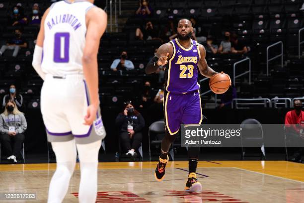LeBron James of the Los Angeles Lakers dribbles the ball during the game against the Sacramento Kings on April 30, 2021 at STAPLES Center in Los...