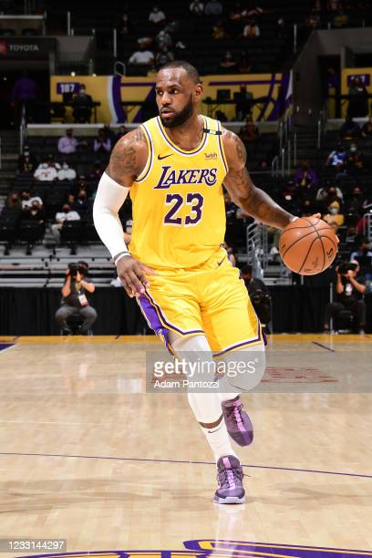 LeBron James of the Los Angeles Lakers dribbles the ball during the game against the Phoenix Suns during Round 1, Game 3 of the 2021 NBA Playoffs on...