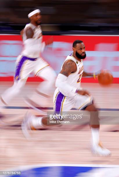 LeBron James of the Los Angeles Lakers dribbles the ball during the second quarter against the Denver Nuggets in Game Three of the Western Conference...
