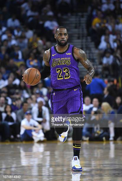 LeBron James of the Los Angeles Lakers dribbles the ball up court against the Golden State Warriors during the first half of their NBA Basketball...