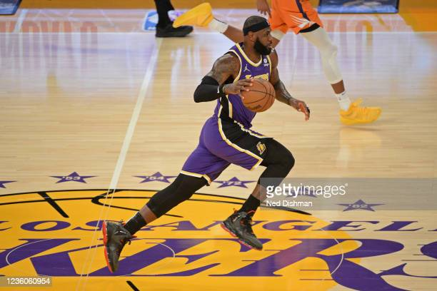 LeBron James of the Los Angeles Lakers dribbles the ball up court against the Phoenix Suns on October 22, 2021 at STAPLES Center in Los Angeles,...