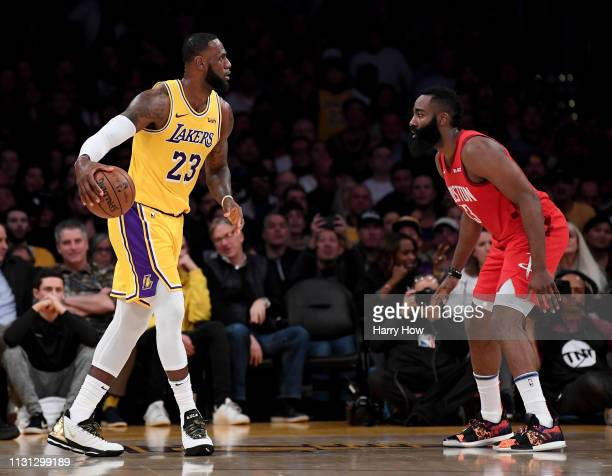 LeBron James of the Los Angeles Lakers dribbles toward James Harden of the Houston Rockets during the first half at Staples Center on February 21...