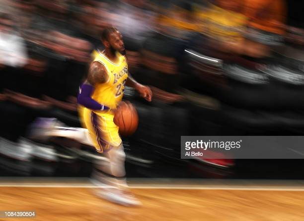 LeBron James of the Los Angeles Lakers dribbles upcourt against the Brooklyn Nets during their game at the Barclays Center on December 18 2018 in New...