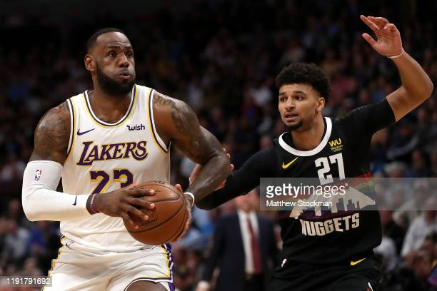 Lebron James of the Los Angeles Lakers drives against Jamal Murray of the Denver Nuggets in the first quarter at Pepsi Center on December 03 2019 in...