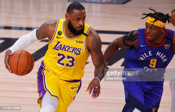 LeBron James of the Los Angeles Lakers drives against Jerami Grant of the Denver Nuggets during the third quarter in Game One of the Western...