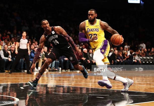 LeBron James of the Los Angeles Lakers drives against Rondae HollisJefferson of the Brooklyn Nets during their game at the Barclays Center on...