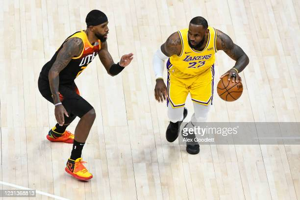 LeBron James of the Los Angeles Lakers drives into Royce O'Neale of the Utah Jazz during a game at Vivint Smart Home Arena on February 24, 2021 in...