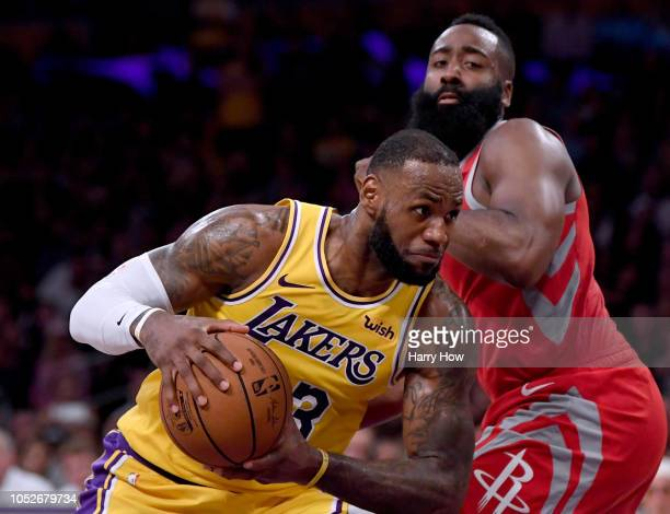 LeBron James of the Los Angeles Lakers drives on James Harden of the Houston Rockets during a 124115 Rockets win at Staples Center on October 20 2018...