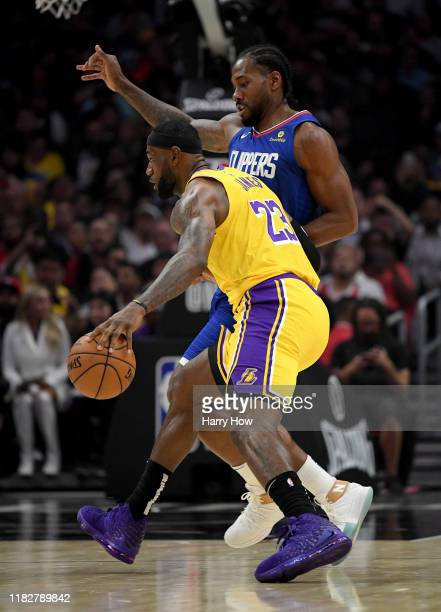LeBron James of the Los Angeles Lakers drives on Kawhi Leonard of the LA Clippers during the first half in the LA Clippers season home opener at...