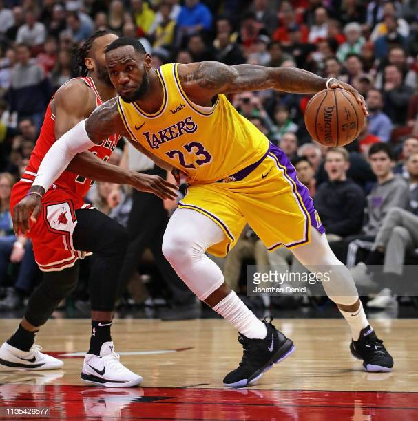LeBron James of the Los Angeles Lakers drives past Wayne Selden of the Chicago Bulls at the United Center on March 12 2019 in Chicago Illinois NOTE...