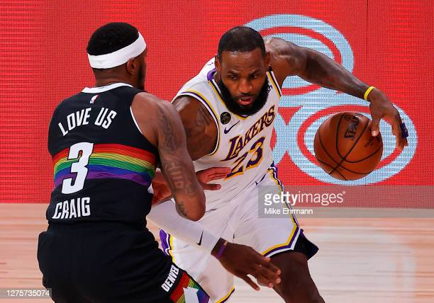 LeBron James of the Los Angeles Lakers drives the ball against Torrey Craig of the Denver Nuggets during the second quarter in Game Three of the...