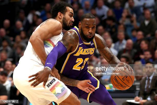 Lebron James of the Los Angeles Lakers drives to the basket against Trey Lyles of the Denver Nuggets in the first quarter at the Pepsi Center on...