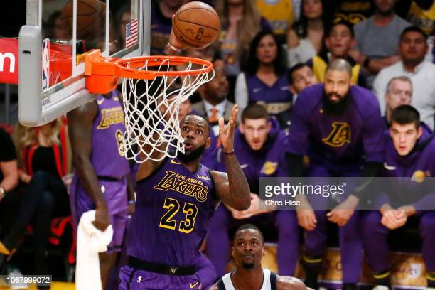 LeBron James of the Los Angeles Lakers drives to the basket against the Dallas Mavericks on November 30 2018 at the Staples Center in Los Angeles...