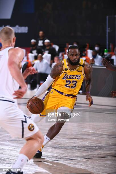 LeBron James of the Los Angeles Lakers drives to the basket against the Denver Nuggets on August 10 2020 at The AdventHealth Arena in Orlando Florida...