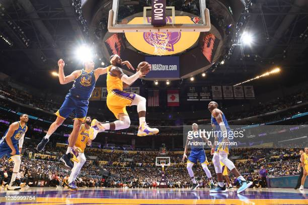 LeBron James of the Los Angeles Lakers drives to the basket against the Golden State Warriors on October 19, 2021 at STAPLES Center in Los Angeles,...